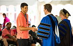 President Peter Eden welcomes a new student during convocation on September 1, 2018.
