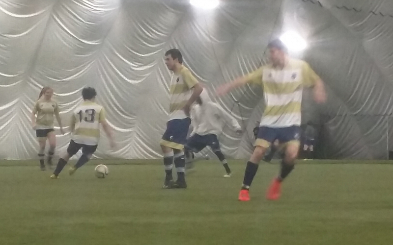 Indoor Soccer players warm up