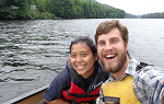 Josh Ascani and a student take a selfie from a canoe on the Connecticut River.
