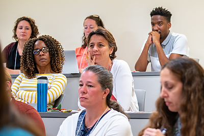 A group of Summer Institute audience members listening to a presentation