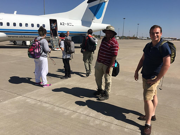 Students on 2019 Study Abroad trip deplane onto tarmac at Maun Botswana