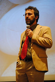 Image of Dr. Micah Altman holding microphone