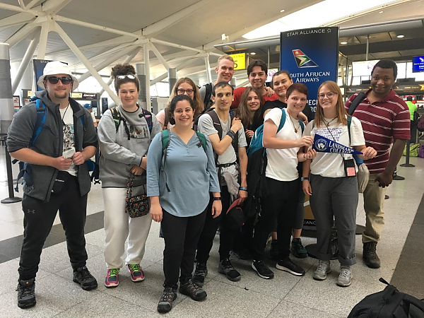 Students on 2019 Study Abroad trip to Bostwana pose for a group photo at JFK airport before departing.