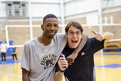 Two Landmark students pose for the camera during a volleyball game in the Click Family Athletic Center.