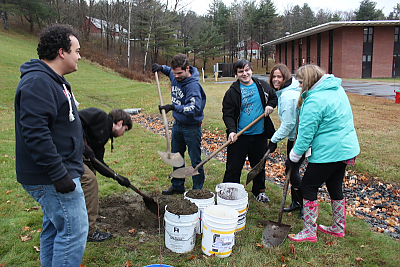 Students planting trees on Landmark College campus