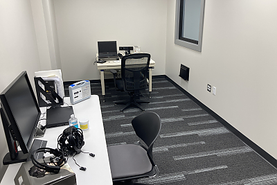Narrow office space with computer and other equipment