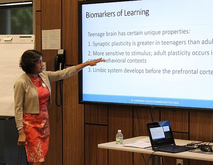 A presenter describes biomarkers of learning