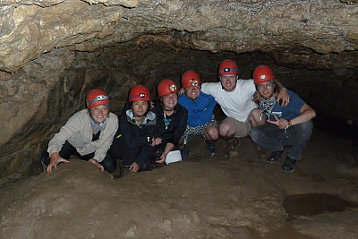 Landmark students posing with their helmets after doing some caving