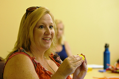 A participant at the Summer Institute uses a manipulative.