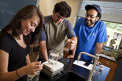 Photo of three students working together in a Life Science lab.
