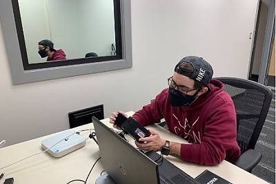 Student working with eye tracking equipment