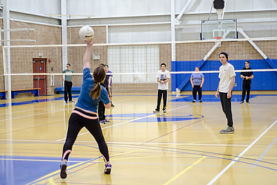 Landmark College students playing volleyball in Click Center