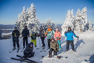 Landmark College skiers stop for a photo on mountain summit.