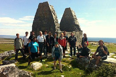 Landmark College students in Ireland stand in front of pyramidal stone monuments