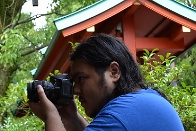 student taking a photo at Japanese shrine