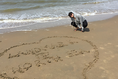 Student at the north sea with a sand design