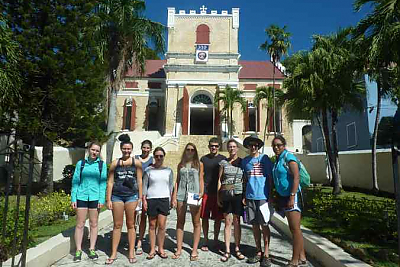 Landmark College students on Caribbean Islands program stand in front of church in Caribbean
