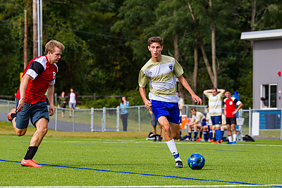 Landmark College soccer player moves the ball