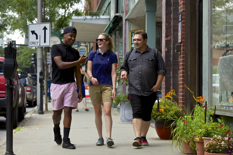 Three Students Walk Down Street In Brattleboro