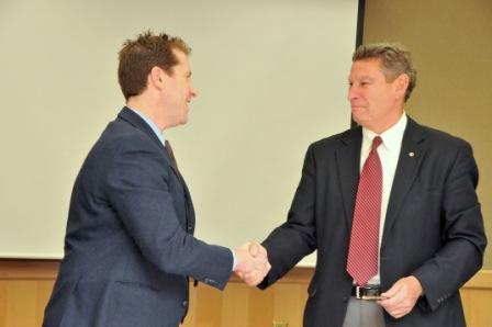 Dr. Eden and Ron Stahley shake hands after signing agreement