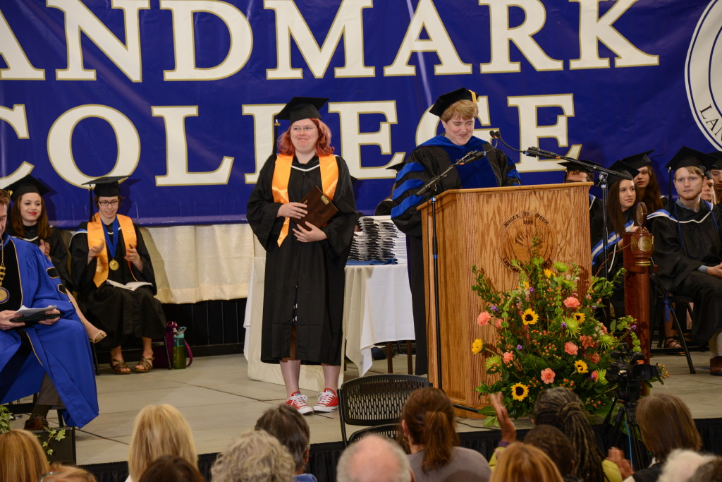 Molly Nelson at podium with Gail Gibson on graduation stage