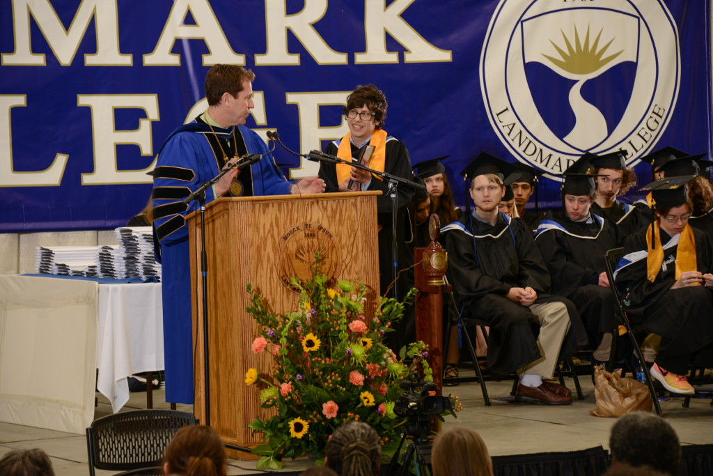 Ben-Raskin Gross at podium with Peter Eden on graduation stage