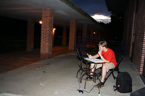Student studying al fresco (library)