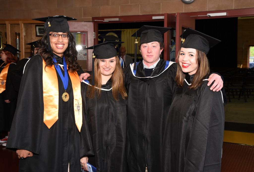 Graduates pose in Click Family Sports Center