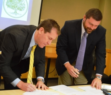 President Eden and Headmaster at Greenwood School sign MOU
