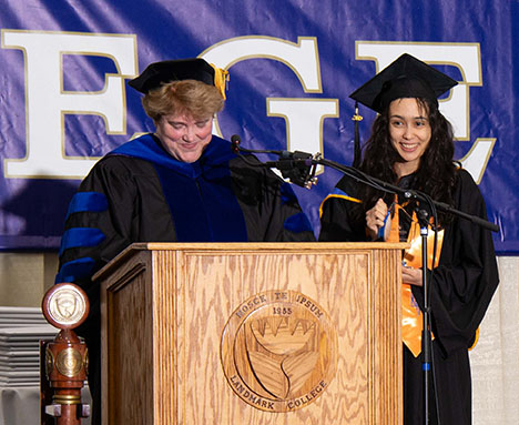Anais Sidonia accepts the Academic Deans' Award for Associate Degree from Vice President of Academic Affairs Gail Gibson Sheffield during the 2019 Spring Commencement ceremony
