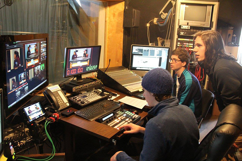 Landmark College students in the broadcast control room at Brattleboro Community Television.