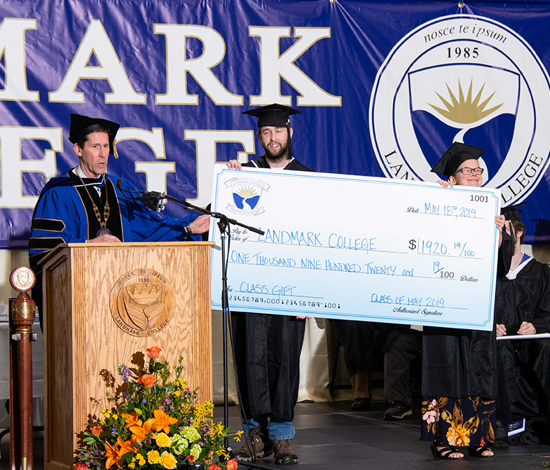 Cullen Elwell (center) and Megan Freeman (right) present the 2019 Graduating Class Gift to Landmark College president Dr. Peter Eden (left). The $1,920.19 will be used to establish a scholarship in honor of IT staff member Jim Philopena and help create a STEM maker space.