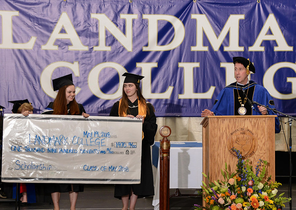 Students present President Eden with Class Gift, a check in the amount of $1,970.18.