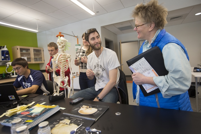 Science professor with students in science lab