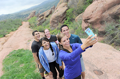 young adults taking group selfie at Red Rocks