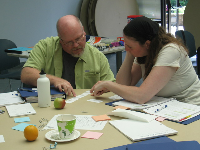 An instructor reviews material with a student