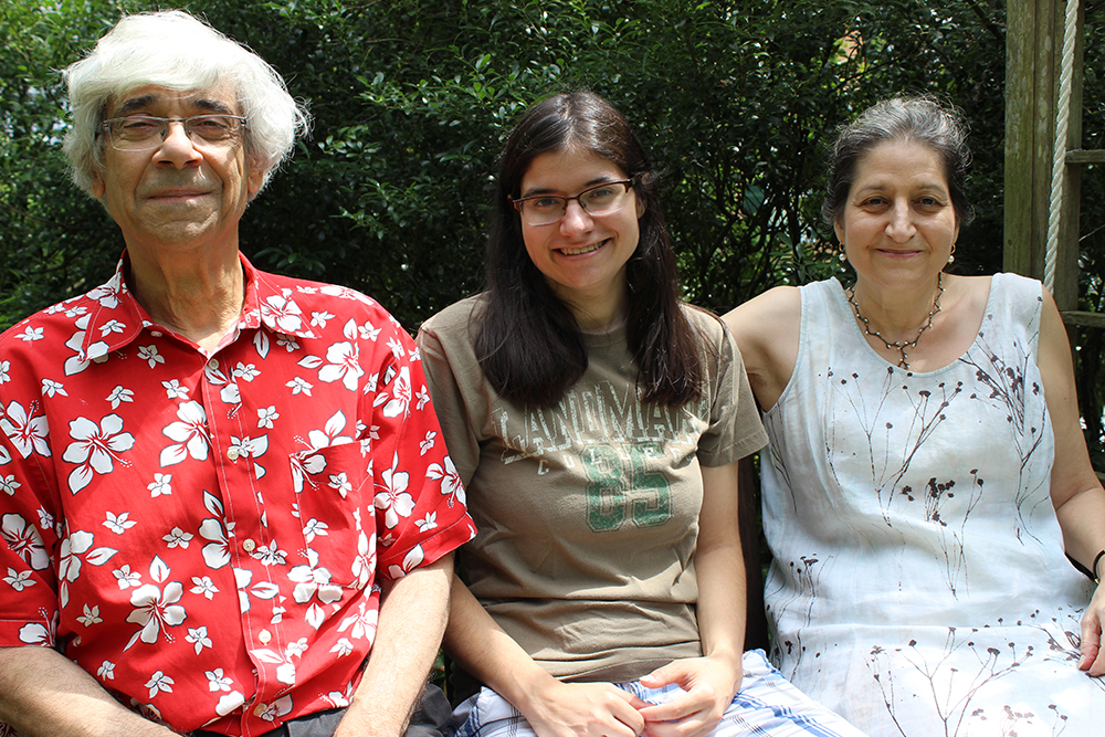 Harold Nahigian (left), Jessica Nahigian (middle), and Linda Kaboolian (right) pose for a photo in an outdoor area of their home in Cambridge, Massachusetts