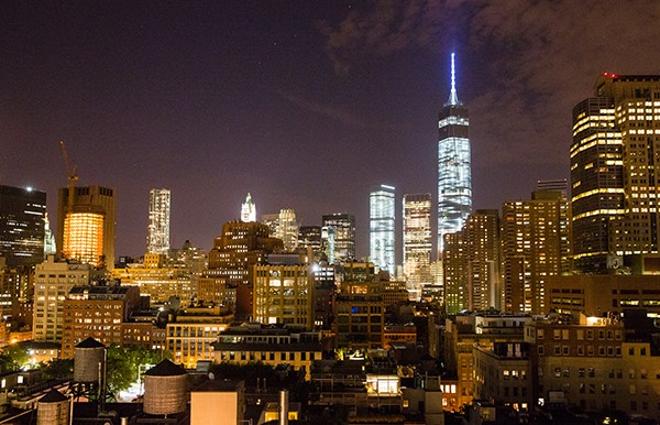 A night time view of the Manhattan skyline, including the Freedom Tower, taken from Tribeca Rooftop.