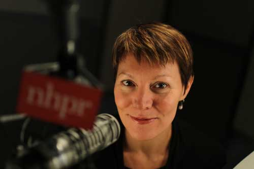 Headshot of Virginia Prescott at microphone